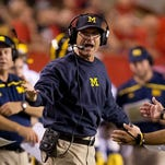 First-year Michigan coach Jim Harbaugh has the Wolverines playing well. Michigan travels to Michigan State on Saturday