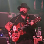 Country music star Zac Brown says he was in the wrong place at the wrong time when a drug bust happened.