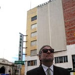 """William """"Billy"""" Abraham is shown in front of American Furniture building in 2010."""