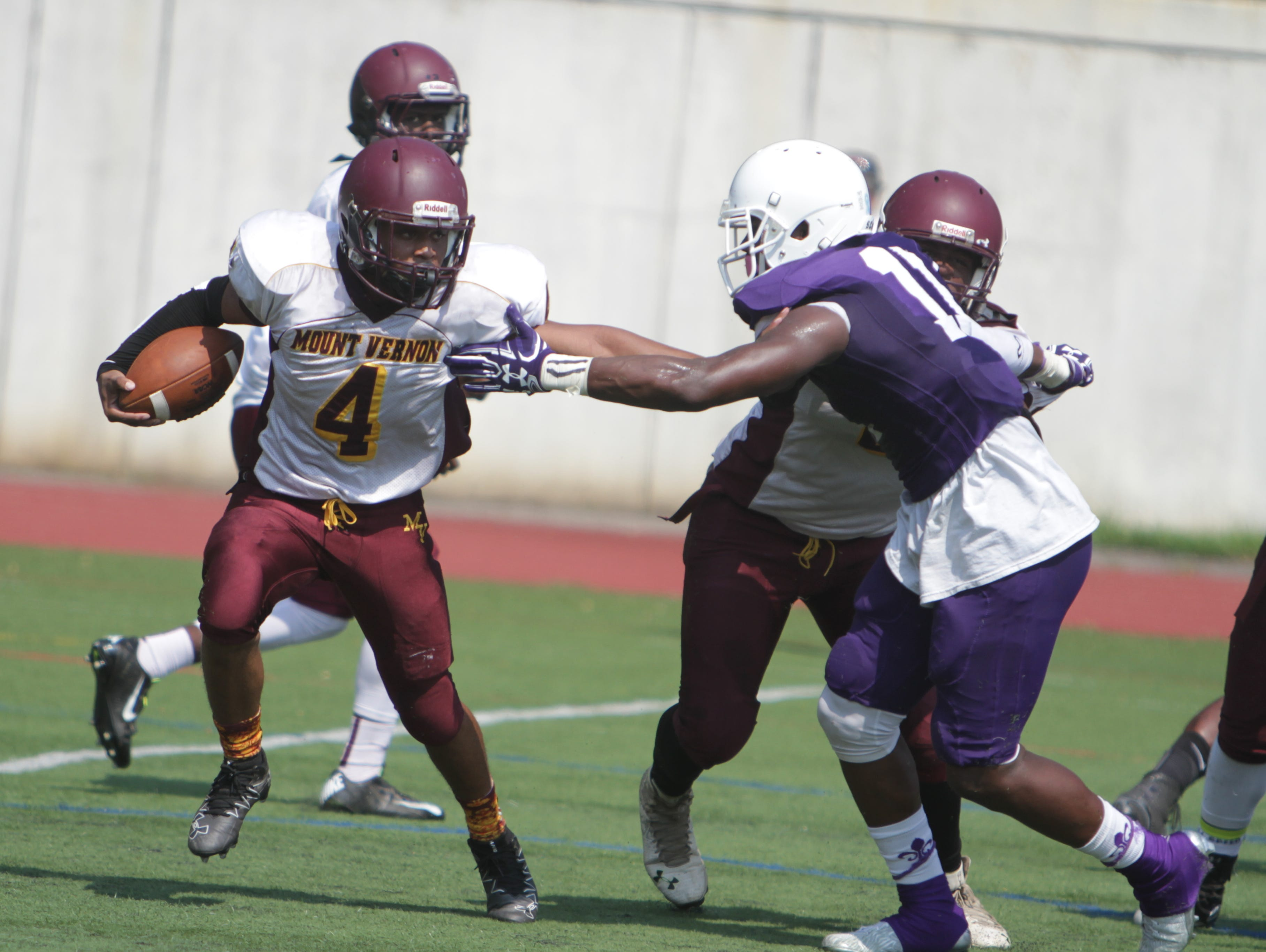 Mount Vernon's Carlton Naughton attempts to hold off New Rochelle's Khairi Manns during a Section 1, Class AA football game between New Rochelle and Mount Vernon at New Rochelle High School on Sept. 10th, 2016. New Rochelle won 40-6.