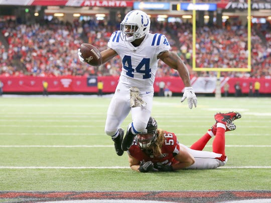 Indianapolis Colts running back Ahmad Bradshaw (44) rushes the ball into the end zone as he's contacted by Atlanta Falcons outside linebacker Brooks Reed (56) at the goal line during the second half of an NFL football game Sunday, Nov. 22, 2015, at the Georgia Dome in Atlanta, Georgia.