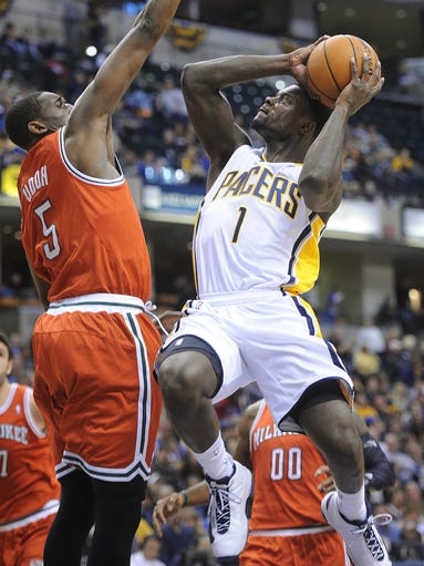 Lance Stephenson goes to the basket against Ekpe Udoh of the Bucks. The Pacers hosted the Milwaukee Bucks in NBA action at Bankers Life Fieldhouse Friday November 15, 2013. Rob Goebel/The Star.