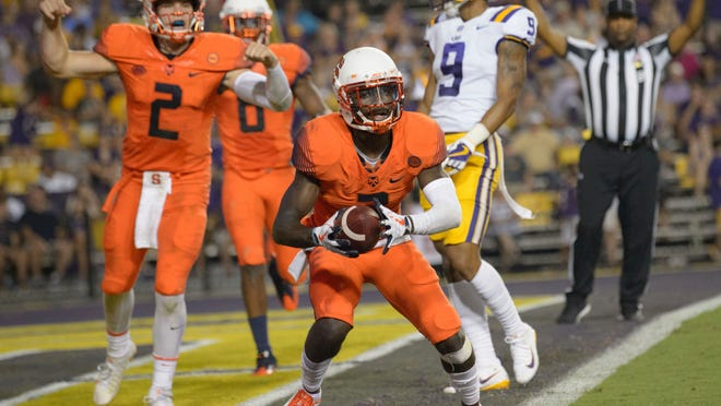 Syracuse wide receiver Ervin Philips (3) scores a touchdown against LSU during the second half as quarterback Eric Dungey (2) celebrates in the end zone during an NCAA college football game in Baton Rouge, La., Saturday, Sept. 23, 2017. (AP Photo/Matthew Hinton)