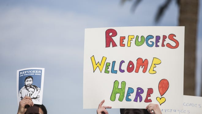 People gather in support of immigrants and refugees during an inter-faith gathering in Phoenix in February.
