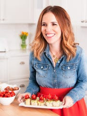 "An image of Rachel Hollis from the cover of her cook book ""Upscale Downhome: Family Recipes, All Gussied Up"""
