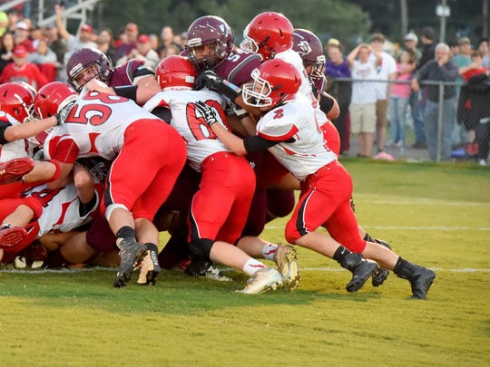 Stuarts Draft players push towards the end zone as Riverheads players try to keep them from it. Draft makes it in for a touchdown on the play during a football game played in Stuarts Draft on Friday, Sept. 8, 2017.