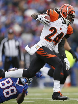 Bengals cornerback Adam Jones breaks a tackle on a kick return by Bills wide receiver Marquise Goodwin in the first quarter.
