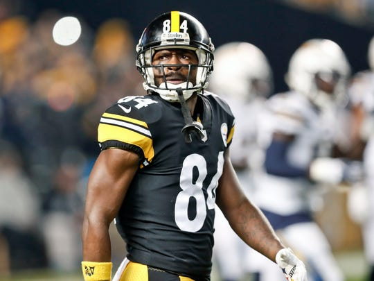 FILE - In this Dec. 2, 2018, file photo, Pittsburgh Steelers wide receiver Antonio Brown (84) plays against the Los Angeles Chargers in an NFL football game, in Pittsburgh. Antonio Brown wants out of Pittsburgh. A person with knowledge of the situation tells The Associated Press the perennial Pro Bowl wide receiver has asked the Steelers for a trade. The person spoke on the condition of anonymity because he was not permitted to publicly discuss personnel matters. Brown appeared to make his decision official in a social media post released on Instagram on Tuesday, Feb. 12, 2019. (AP Photo/Don Wright, File)