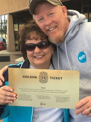 Karen and Brian Massey show their lucky ticket before departing from Abilene Regional Airport for their free trip to Austria, Germany and Ireland, provided by the genetic testing company 23andMe.