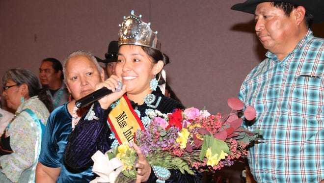 Miss Indian New Mexico Megan Badonie of the Navajo Nation greets the audience at the pageant on Saturday at the Albuquerque Convention Center.