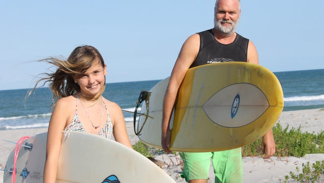Jan Boeje and his daughter, Caroline, surf together at least once a week- more if the waves are good.