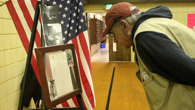 Kenneth Kartie of Sterling Heights looks at a copy of a letter written by an American soldier on Adolf Hitler's personal stationery from World War II. The letter, owned by Livonia resident Tom Klisz, was on display for a Michigan Treasure Hunters meeting Tuesday in Livonia.