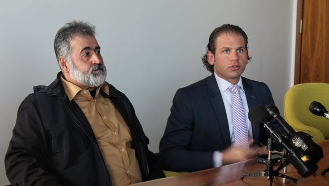 Salim Younes, left, and attorney Jonathan Marko speak before reporters Monday in Marko's law office in downtown Detroit. Younes recently released video footage shot in 2015 from a hidden camera in his father's room at Autumnwood of Livonia that he says shows patterns of abuse by staff at the facility.