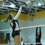 Harrison's Kaille O'Keefe  (middle) faces North Farmington's Arieana Hemphill (left) and Dayla Hall (right) at the net during the FPS volleyball tournament Thursday.