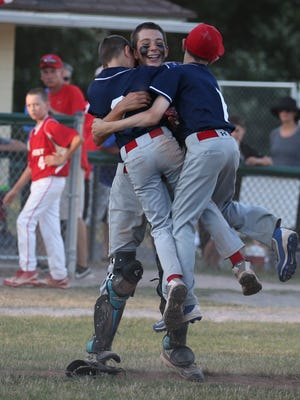 Enfield's Alex Touloupas, left, and Matt Salina, right, leap into the arms of catcher John Schoenhardt, as they celebrate after the final out giving them the victory during the District IV Little League Baseball Tournament finals Thursday, July 14, 2016 at the Penfield Little League Complex.  Penfield beat Fairport 6-4.