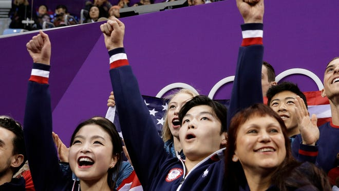 Alex Shibutani and Maia Shibutani of the United States react as their score is posted following their performance in the ice dance free dance figure skating Team Event in the Gangneung Ice Arena at the 2018 Winter Olympics in Gangneung, South Korea.