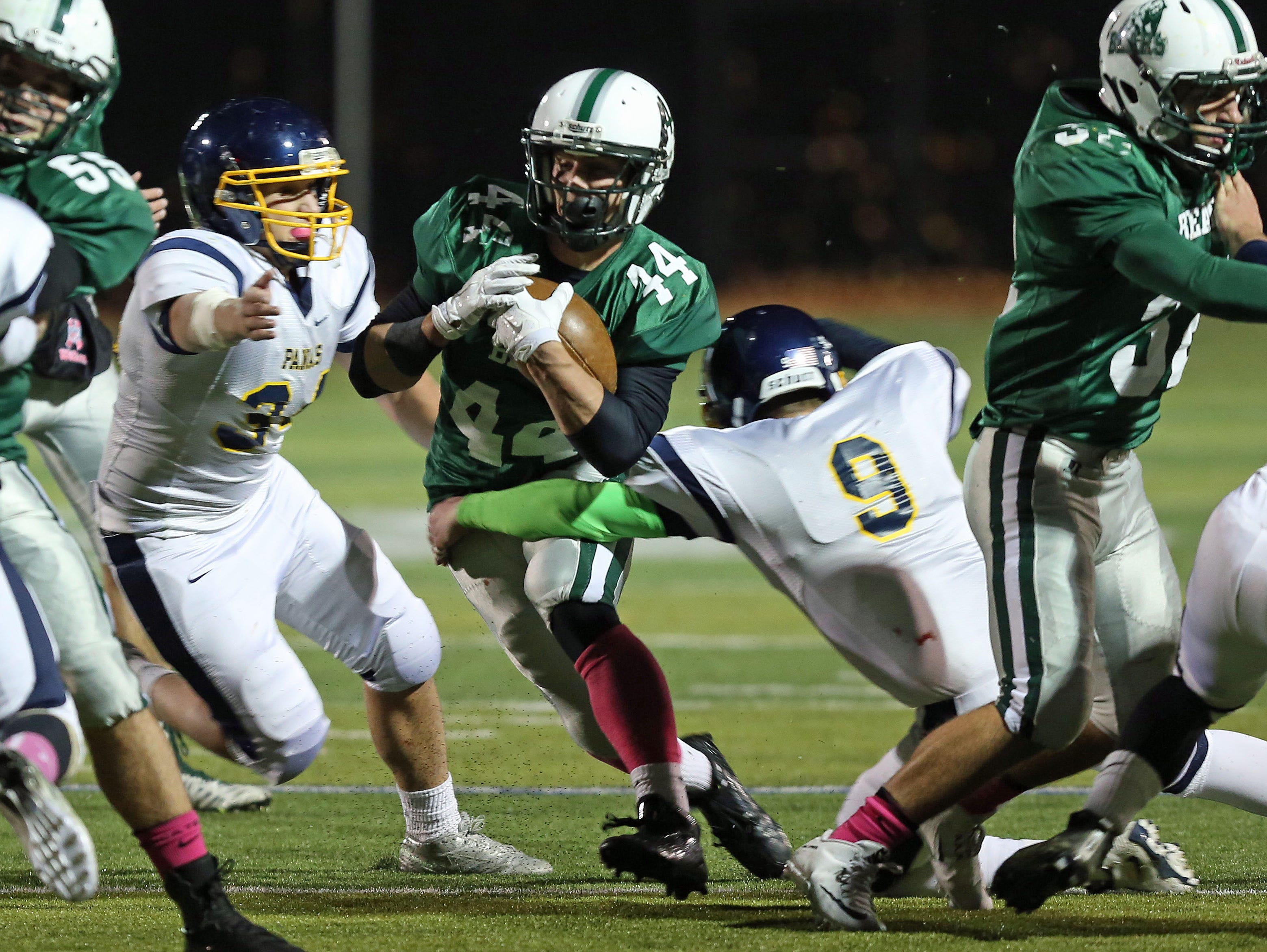 Brewster's Jack Guida (44) looks for some running room in the Panas defense during football action at Brewster High School Oct. 17, 2015.