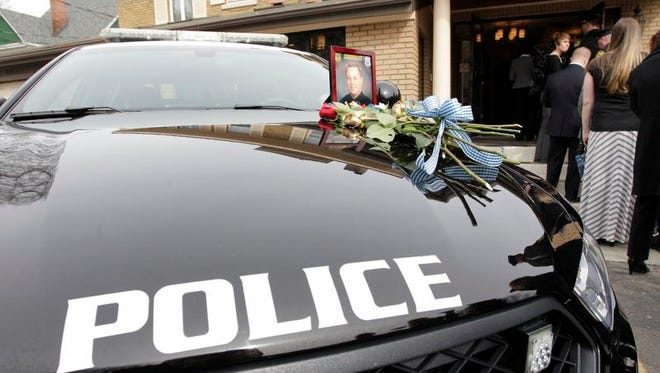 Well wishers pay respects April 3, 2014, at Chase Funeral Home, in Port Dickinson during calling hours for Johnson City Officer David Smith, who was killed in the line of duty.