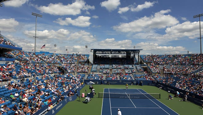 Dmitry Tursunov of Russia and Juan Martin Del Potro of Argentina play on Center Court during the Western and Southern Open at the Lindner Family Tennis Center in Mason. Photo shot Friday August 16, 2013. The Enquirer/ Cara Owsley