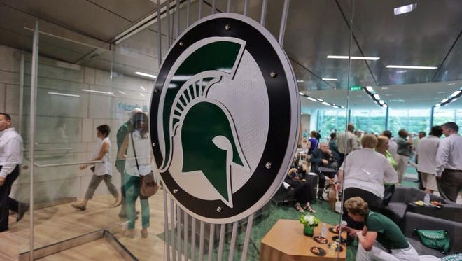 Guests enter the Spartan Engagement Center in the Demmer Family Pavilion on Monday, Aug. 25, 2014 during a tour of the new North End Zone Complex renovations at Spartan Stadium in East Lansing on the Michigan State Campus.