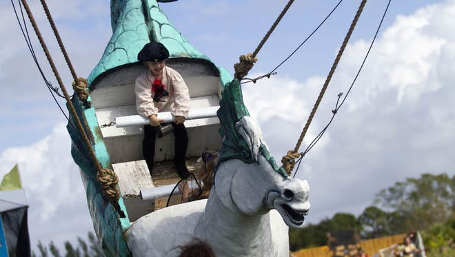 Taegan Jeffcoat, 5, of Fort Myers rides on the Seahorse at the Medieval Faire on Saturday.