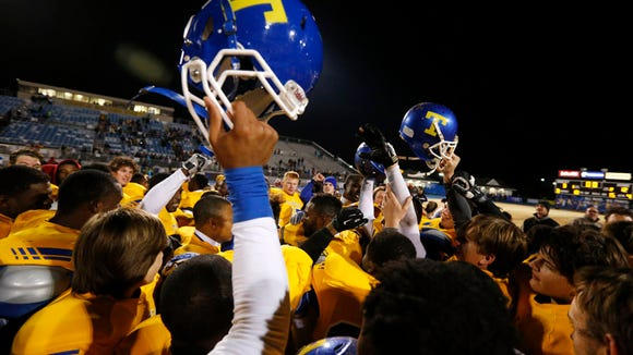 Tupelo High School football players celebrates their 12-3 win over South Panola in the North Half State Championship game Friday night.
