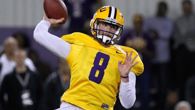 LSU quarterback Zach Mettenberger throws the ball during NFL football pro day.
