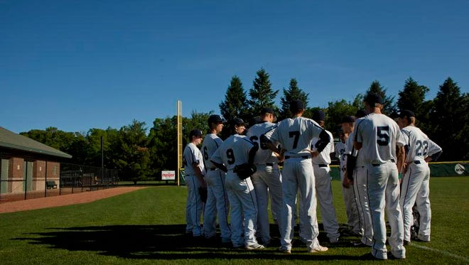 Richmond players talk in a huddle before a Division 2 state championship baseball game June 14, 2014 at McLane Stadium in East Lansing. Mount Pleasant won 7-2.