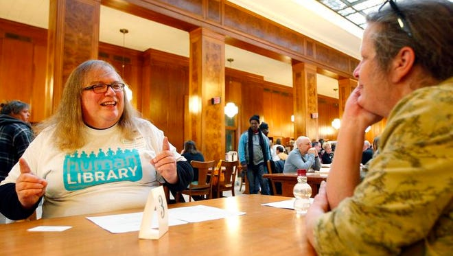 "Shauna O'Toole, left, talks with Dorothy Page, both of Rochester, about her transgender experiences at the University of Rochester's ""Human Library"" event on Saturday."