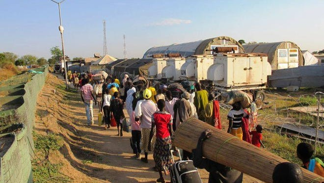 South Sudanese refugees headed for UN compounds and safety outside the capital Juba.