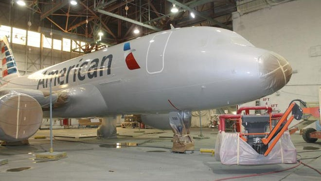 A fresh coat of paint is applied to the Airbus A319 with the tail number N700UW. It became the first US Airways aircraft to be painted in the American livery.