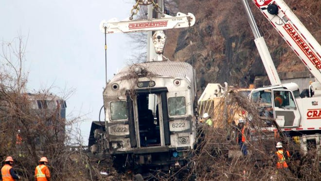 On Dec. 2, a crew removes the last rail car from the Dec. 1 derailment in the Bronx. The Metro-North Railroad crash killed four people.