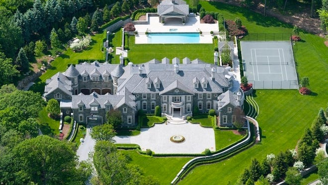 The 30,000-square-foot Stone Mansion in Alpine, N.J., has 12 bedrooms and 19 bathrooms. The exterior is New York state granite and Indiana limestone.