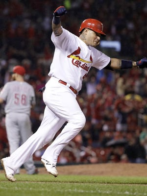 Yadier Molina homered off of Dan Straily in the fifth inning and drove in the winning run in the ninth against Cincinnati.