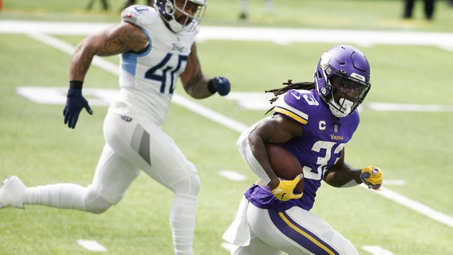 Minnesota Vikings running back Dalvin Cook runs away from Tennessee Titans outside linebacker Kamalei Correa during the Vikings' loss Sunday. Cook is third in the NFL in rushing.