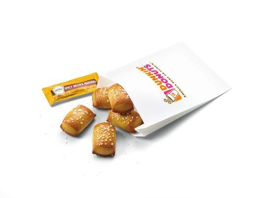 Dunkin' Donuts launches five new snacks for Dunkin' Run menu.