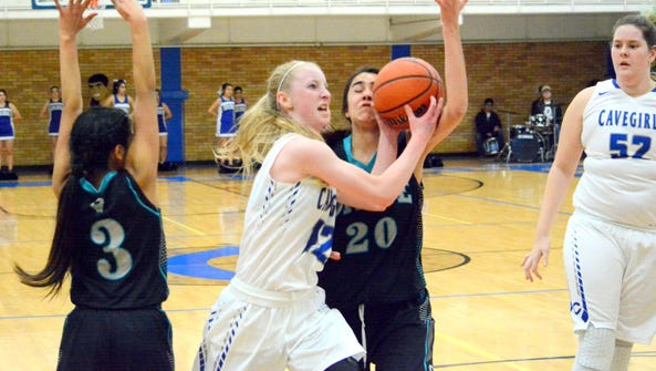 Carlsbad's Carsyn Boswell atttacks the basket in the