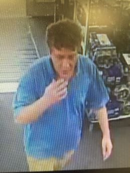 A man was seen taking photos up a woman's skirt inside a Laurens Road store.