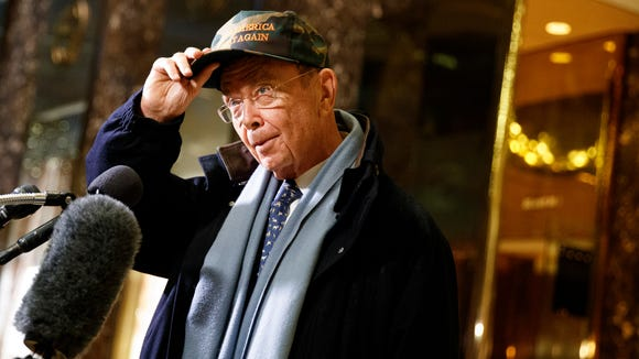 Billionaire investor Wilbur Ross talks with reporters in the lobby of Trump Tower on Nov. 29, 2016, in New York.