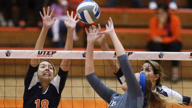 Kylie Baumgartner, 18, of UTEP rises in an attempt to block the ball as Madison McDaniel, 3, of Rice works it over the net Sunday in Memorial Gym on the UTEP campus.