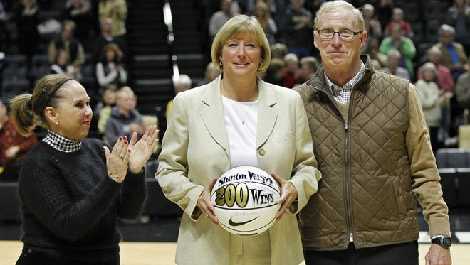 Sharon Versyp is recognized for her 200 victories as Purdue women's head coach by Nancy Cross and Morgan Burke prior to the Boilermakers game with Maine Monday, December 21, 2015, at Mackey Arena. Purdue defeated Maine 56-33.