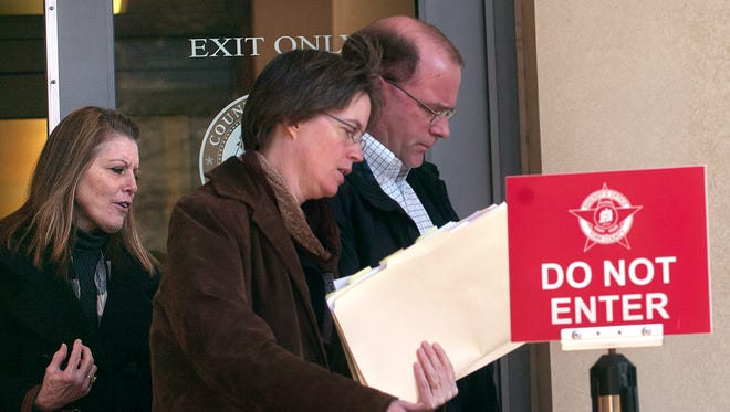 Nanette Craver, left, and her husband, Michael, right, leave the York County Judicial Center on Friday, Nov. 18, 2011 after being sentenced for time served.