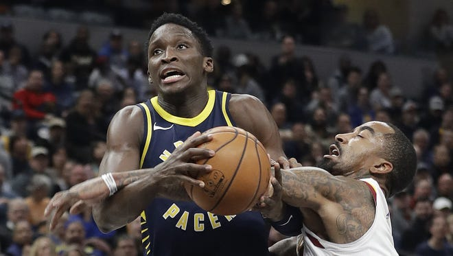The Indiana Pacers' Victor Oladipo (4) is fouled by the Cleveland Cavaliers' JR Smith during the second half of the Pacers 106-102 win on Dec. 8, 2017, at Bankers Life Fieldhouse.