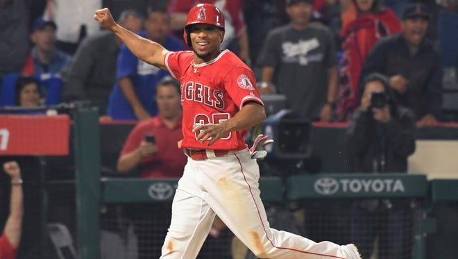 June 28: Angels' Ben Revere scores the winning run on a passed ball in the bottom of the ninth inning after Cameron Maybin strikes out.