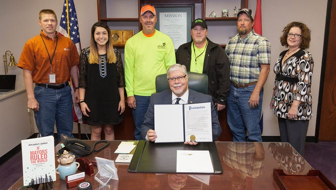 Springfield Mayor Bob Stephens thanks Public Works staff for their service during National Public Works Week with a photo op and proclamation. Left to right are Public Works staff Jason Gabathuler, Bonnie Blevins, Jason Halbert, Brian Powers, Ron Byerly and Dawne Gardner.