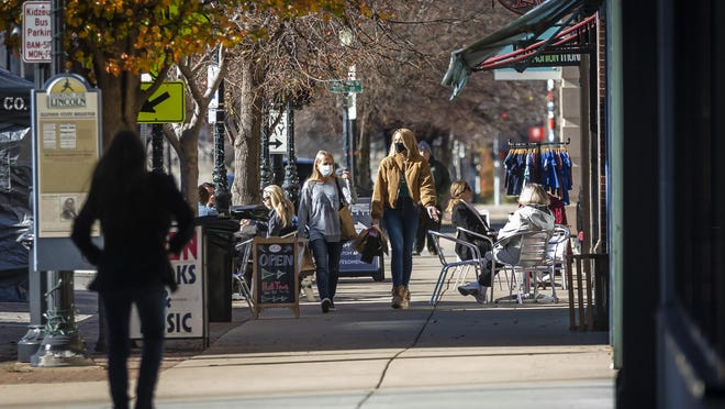 Shoppers make their way along East Adams Street during Small Business Saturday on Nov. 28 in Springfield.