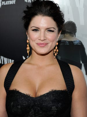 """MMA Fighter / Actress Gina Carano arrives at Relativity Media's premiere of """"Haywire"""" co-hosted by Playboy held at DGA Theater on January 5, 2012 in Los Angeles, California.  (Photo by Frazer Harrison/Getty Images for Relativity Media)"""