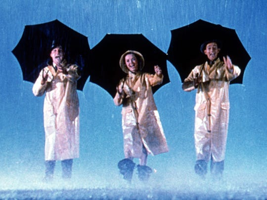"Gene Kelly (left) Debbie Reynolds and Donald O'Connor star in ""Singin' In The Rain."""