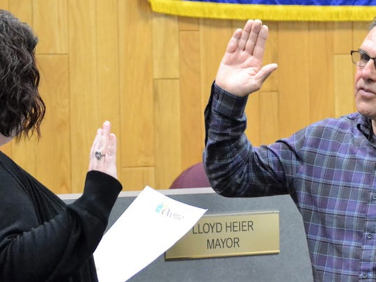 Oconto Mayor Lloyd Heier takes the oath of office for his second term from city administrator Sara Perrizo on April 17 at City Hall.