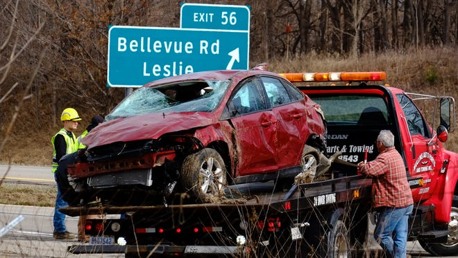 Emergency crews work to clear a one car roll-over accident on south U.S. 127 near Leslie on Saturday.